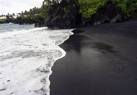 where is the black sand beaches around the world travel around