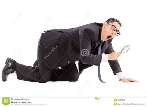 searching for searching for something with a magnifier stock photo
