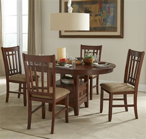 oval dining table set with cushioned side chairs by intercon wolf and gardiner wolf furniture
