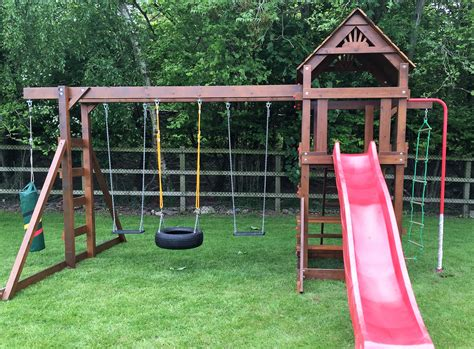 swing on the spiral climbing frame spiral tube slide monkey bars nest swing