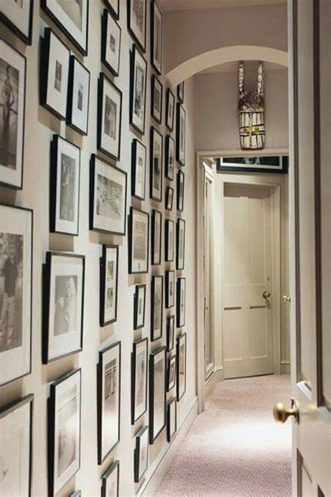 white wall  picture frames  hallway decorating