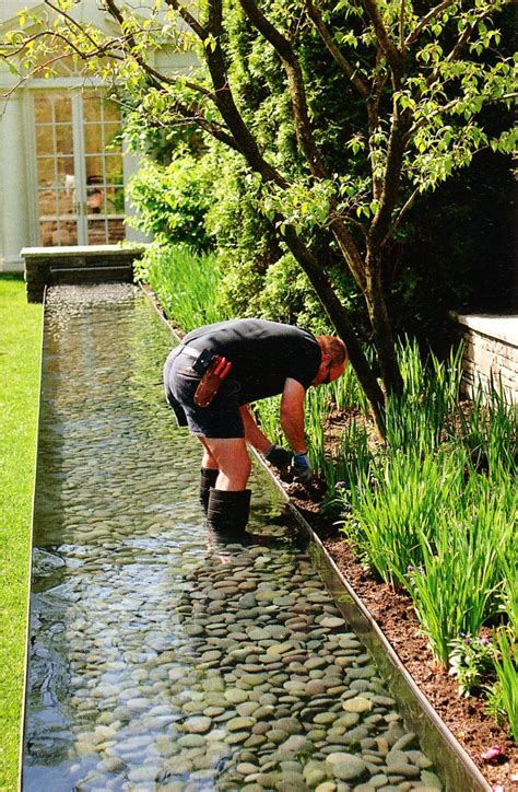 how to build a backyard stream 21 outrageously fun diy projects for your backyard