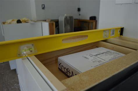 installing base kitchen cabinets diwyatt installing the base cabinets loving here