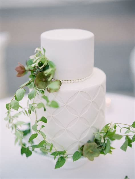wedding cake photography wedding cakes organic greenery topped wedding cake