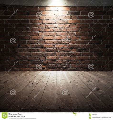 Small D Patch On Interior Wall by Wooden Floor And Brick Wall With Spot Light Stock