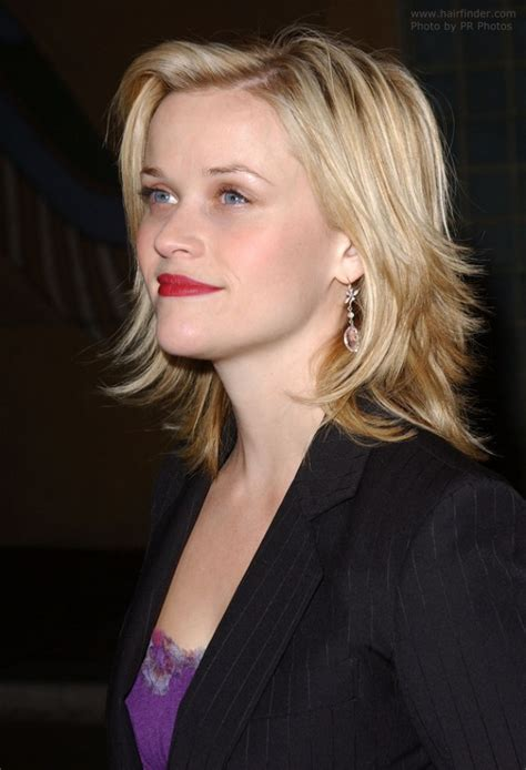 extremely long side latered flipped up hair on sides reese witherspoon sporting a choppy haircut with ends that