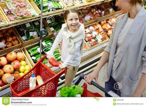 Time To Actually Buy Groceries by Grocery Shopping In Supermarket Stock Photo