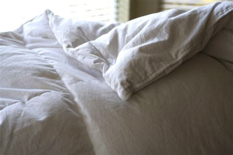chagne coverlet spring cleaning your bedding washing down comforters