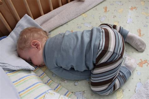 Baby Sleeps On Side In Crib Putting Baby To Sleep Of Baby Sleep