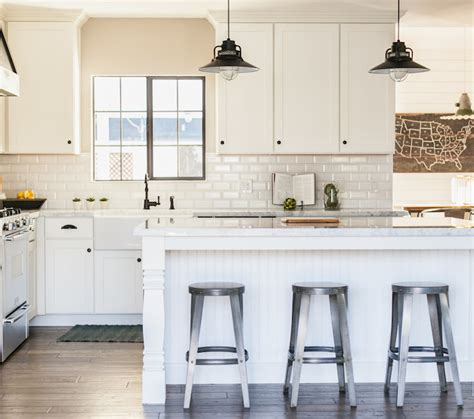bright white kitchen with bronze hardware pictures to pin beveled subway tile backsplash cottage kitchen