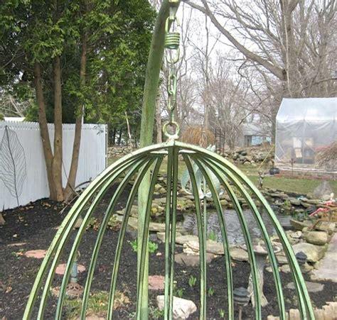 antique garden swing garden swing 80 quot tall wrought iron antique mint green