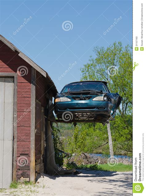 ford mustang hanging from garage stock photo image
