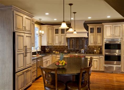 antique cream kitchen cabinets french cream antiqued painted wood cabinetry featuring