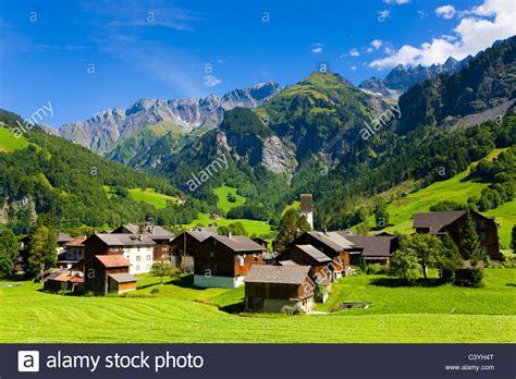 houses to buy in switzerland elm switzerland canton glarus village houses homes church stock photo royalty