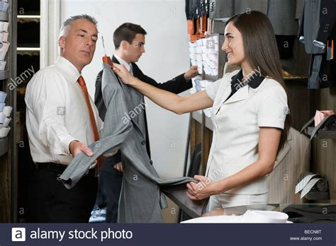 sales clerk assisting a customer in the clothing store