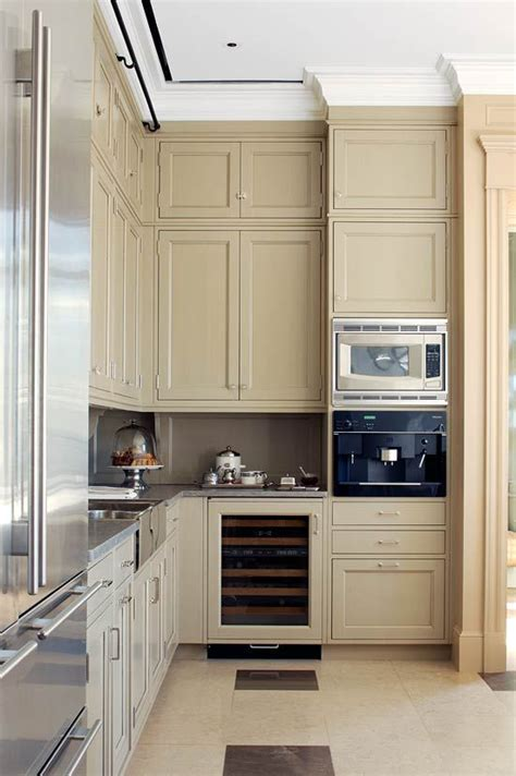 beige kitchen countertops stainless steel appliances and beige painted cabinets create a