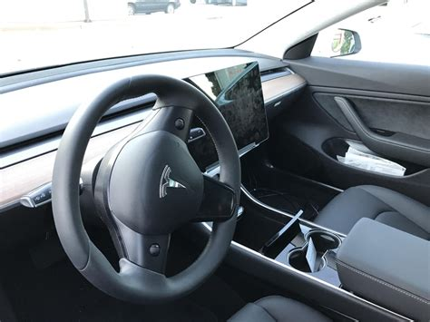 new interior image of tesla model 3 surfaces new model 3 photos surface pointing to 300 mile range