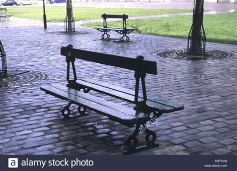 paris park bench empty benches in a park in paris on a rainy day france