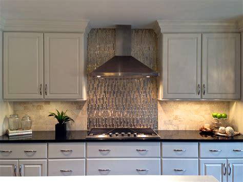 white kitchen cabinets with metal backsplash black and white kitchen viking appliances gold glass and