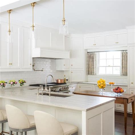 Light Grey Shaker Kitchen White Shaker Cabinets With Light Gray Quartzite Countertops Transitional Kitchen