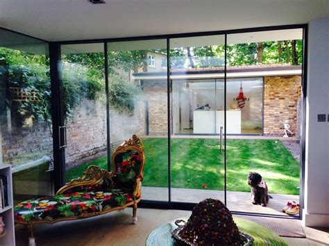 Spain Reminds Designers The Emaciated Look Is Out Cnncom by Frameless Sliding Patio Door System Slimline Glazing