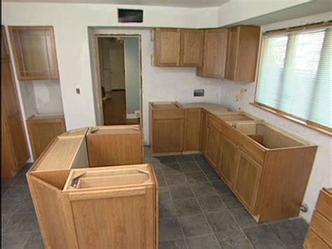 how to install cabinets in kitchen how to hang kitchen cabinets with some flush to appliances