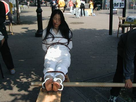 tiger bench torture new york u s a falun gong practitioners stage anti