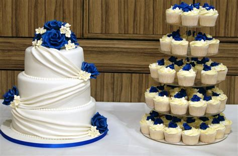 3 tier white wedding cake drapes and blue roses with 5