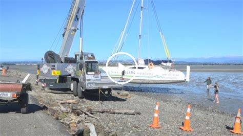 catamaran storm video catamaran lifted by crane back into water after nelson