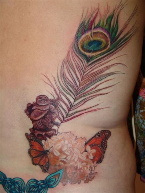 big buddha tattoo traveling buddha and peacock feather 20 beautiful
