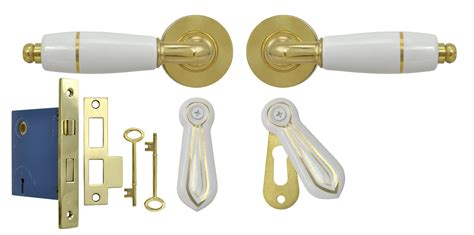 door with gold handle set white porcelain lever door set with gold trim and skeleton