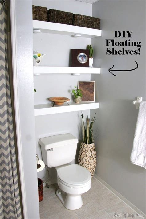 country bathroom with shelves installed above toilet decoist diy floating shelves bathroom above toilet morespoons