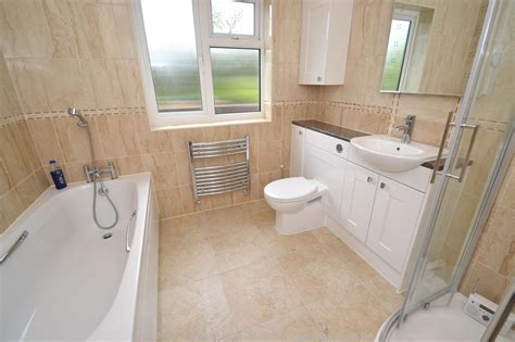 fully tiled bathroom fitted bathroom with knock through in banstead by our