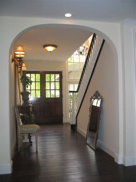 entry with doors espresso hardwood floors