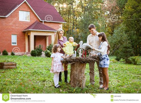 family sitting in backyard of new home stock photos