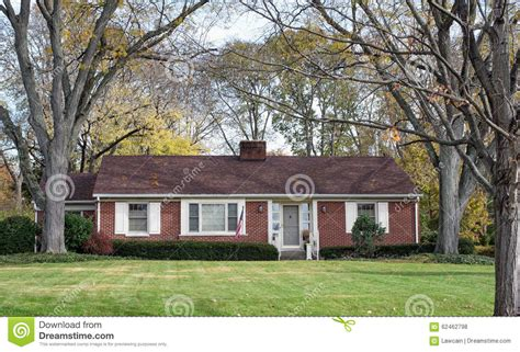 Ranch Country Home Plans by Brick Ranch House In Wooded Setting Stock Photo Image