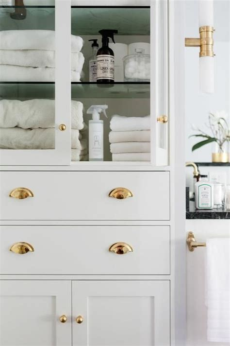 linen cabinet for bathroom glass shelf drawer bath glass front bathroom linen cabinet with polished brass hardware bathroom ideas pinterest