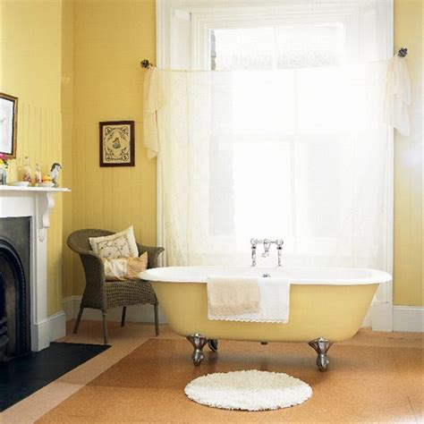 yellow bathroom yellow bathroom with freestanding bath and wicker chair housetohome co uk