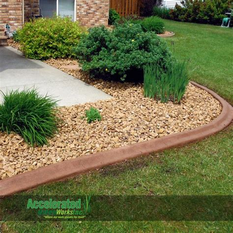 Colored Concrete Curb Edging Blends To Rock Bed While Landscape Bed Edger