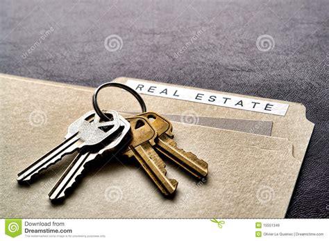 house and key real estate real estate folder and set of house keys on desk royalty