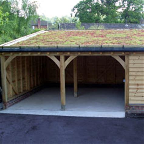 Carport And Garage Designs sloping green roof on oak framed garage summerhouse