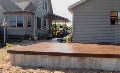 Raised Sted Concrete Patio by A Raised Patio Colored Slab And Foundation Forward