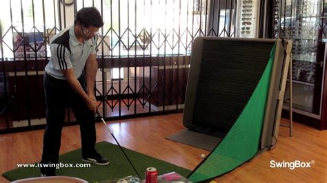 practice golf swing indoors golf practice net swingbox use by golf pro indoors