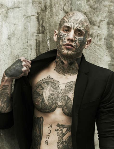 male model tattoos photographs of a model covered in tattoos