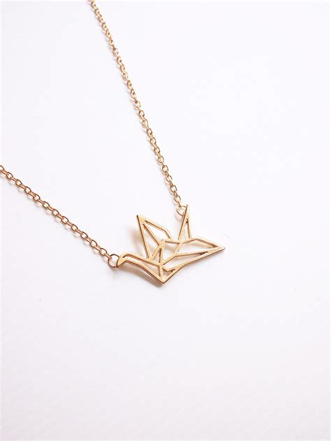 Origami Crane Necklace - back in stock origami crane necklace in gold arva co