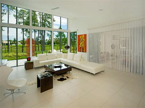 Beige Tiles For Living Room by Open Plan Living Room Using Beige Colours With Tiles Floor To Ceiling Windows Living Area