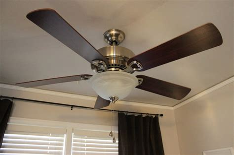 fan that attaches to bed which way should your ceiling fan turn in summer the cool