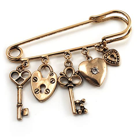 key lock and locket charm safety pin brooch burn