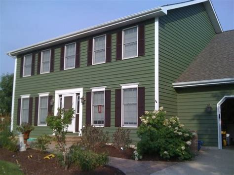 green exterior paint exterior painting green two story traditional home with