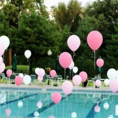 Helium filled balloons tied to weights in pool if you want to create the illusion of floating